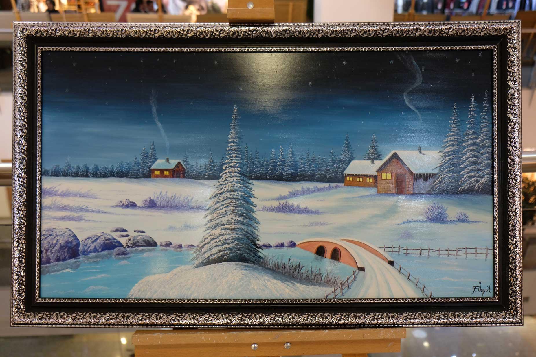 Ein Gemälde, das eine Winterlandschaft zeigt